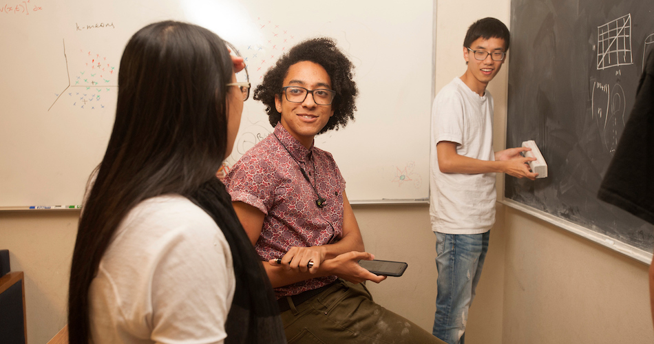 Chutong Wu, Zachary Spaulding, and Yupeng Li , all math majors, work together as they talk about mathematics in the undergraduate math lounge on Tuesday November 14, 2017.