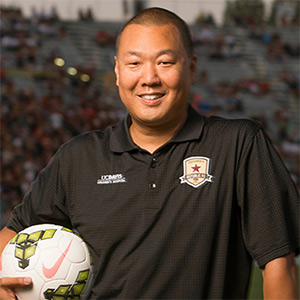 Brent Sasaki, political science major, with soccer ball
