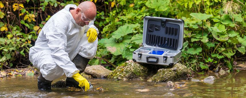scientist looking at creek