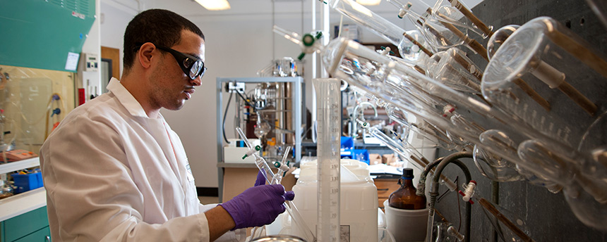 Pharmaceutical chemistry major Manuel Munoz working in a lab