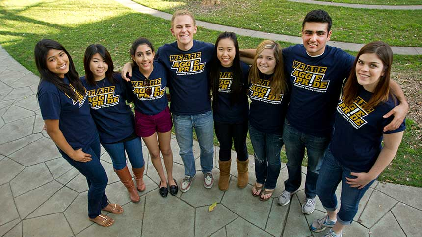 A group of students in a line with Aggie Pride T-shirts