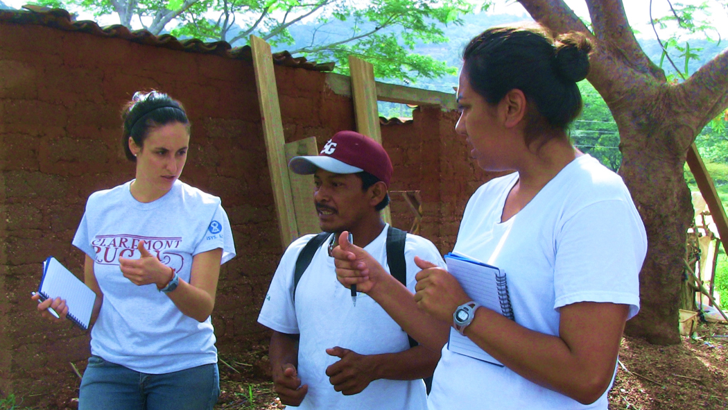 Two veterinarians speaking with a farmer.