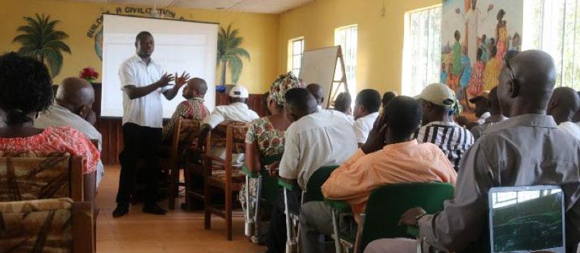Community members attend a PREDICT presentation in Sierra Leone