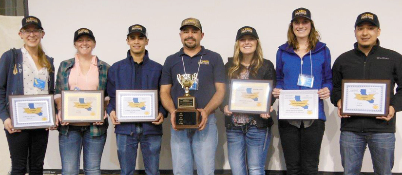 Meat Lab team, holding plaques, posed