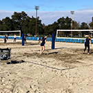 Beach volleyball courts in use.
