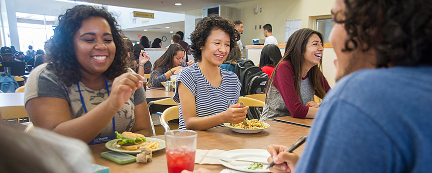 Students eat lunch at a dining hall