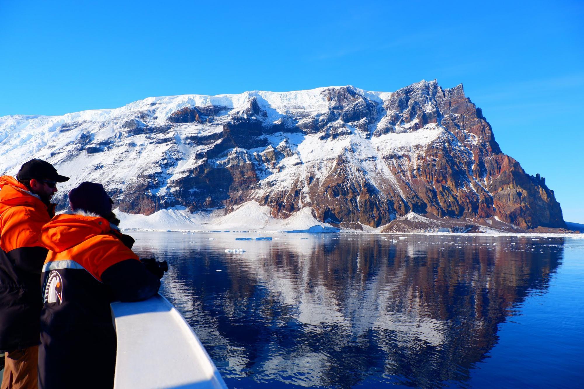 Scientists look over edge of boat in Antarctica
