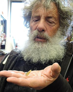 Art Shapiro holds the first cabbage white butterfly of 2017.
