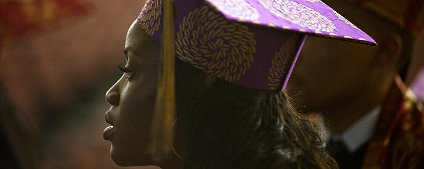 African American woman in a graduation cap