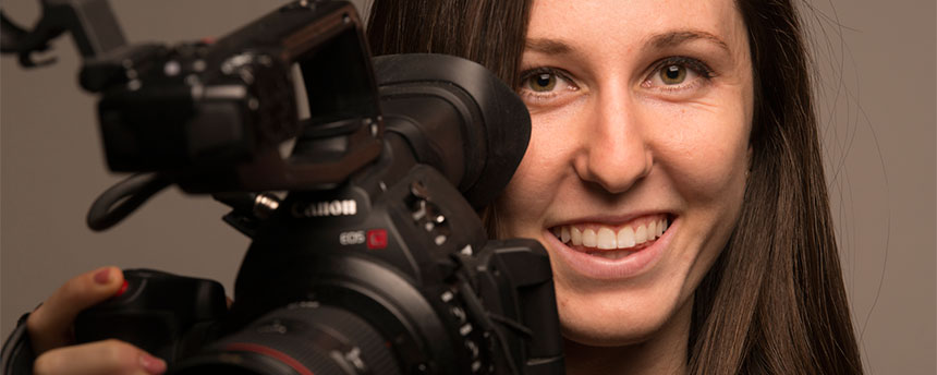 A woman with a video camera