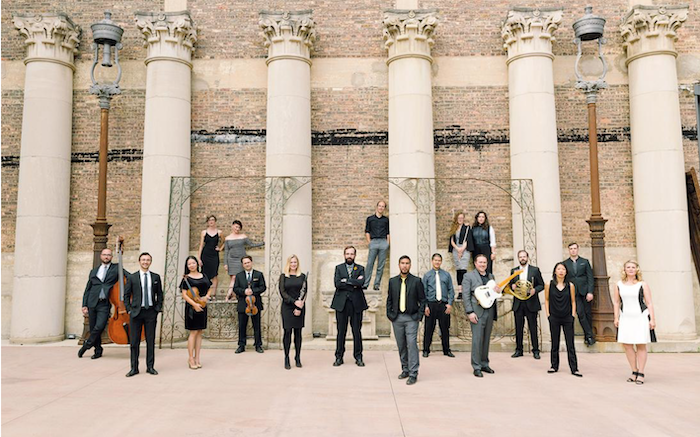 Members of Ensemble Dal Niente standing on front of tall Corinthian columns.