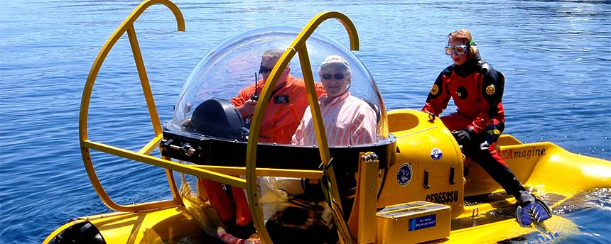 Submarine with two people inside and a diver in the tail end