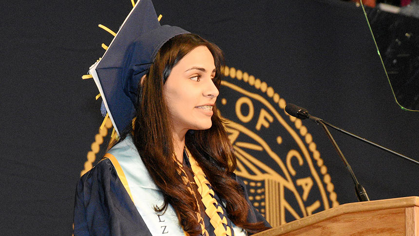 A female student speaks at commencement