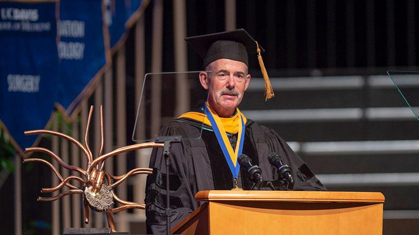 Man at graduation podium