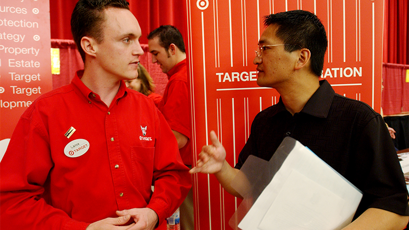 An employer and student talk at a career fair