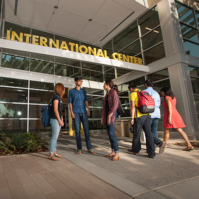 A group of students talking outside the UC Davis International Center