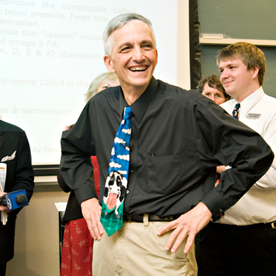 UC Davis Proffessor Ed Depeters celebrates a teaching award he received with his class